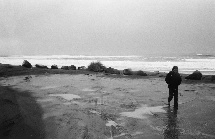 Walking in the rain, by the ocean in Humbolt, CA.  Photo courtesy of the wonderful Neal Casal.