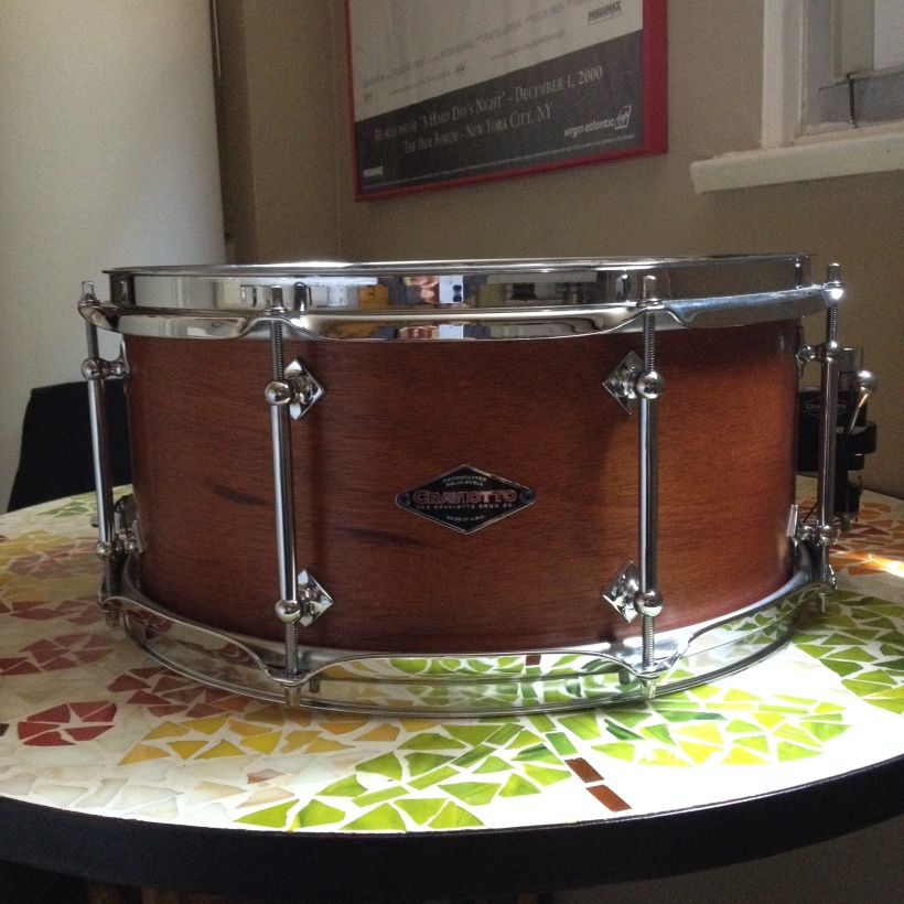 Craviotto 6.5 x 14, 8-lug one-piece Mahogany snare with Maple re-rings. Frickin' gorgeous!