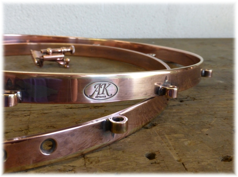 AK 4mm, solid brass single flanged hoops with a copper hand-rubbed finish. Gorgeous!